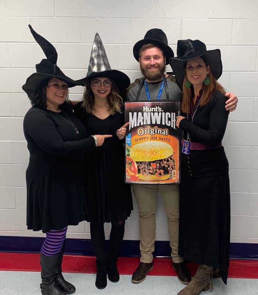 3 teachers dressed up as witches and a male teacher dressed up as Manwich
