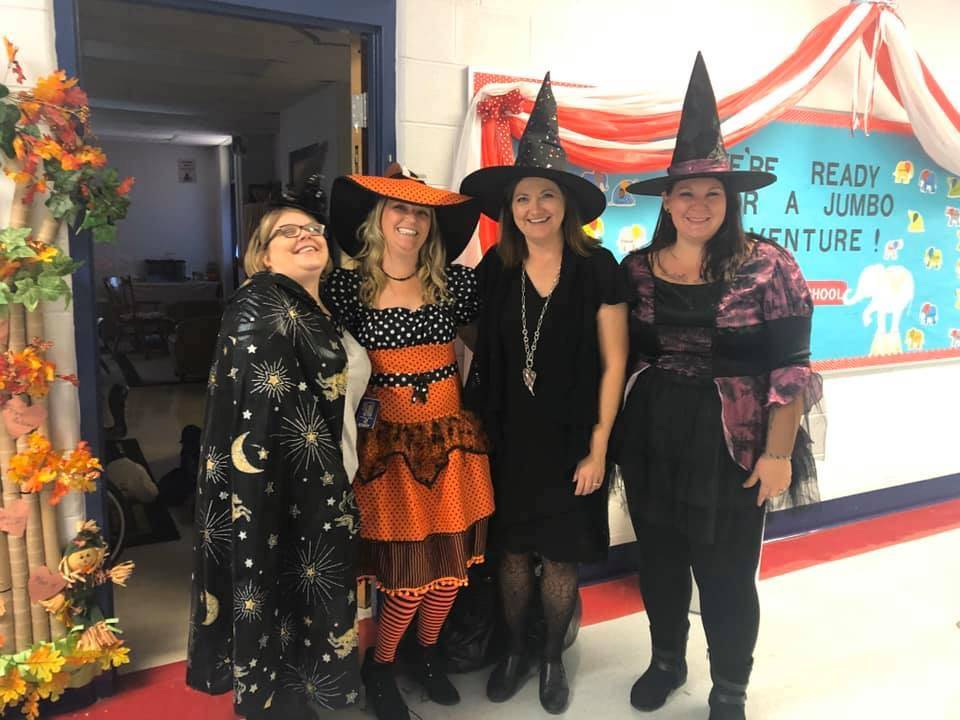 4 teachers in witch costumes