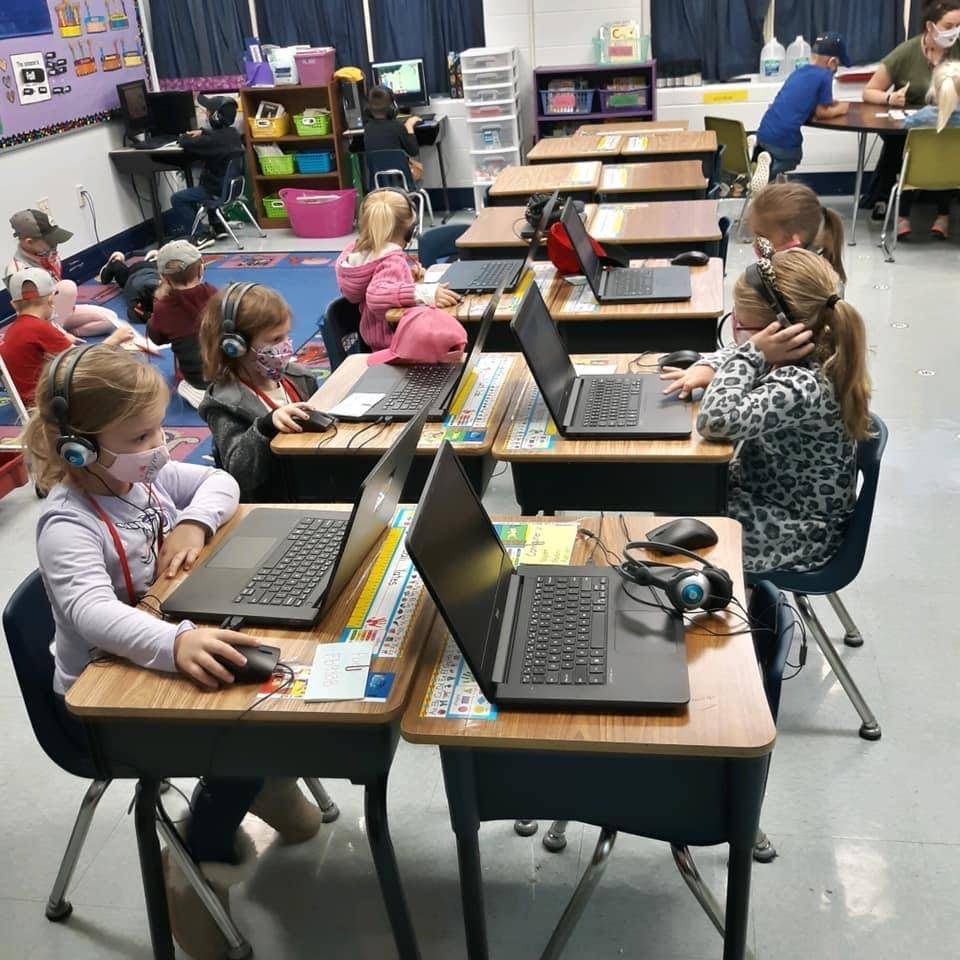 students with headphones on and working on computers
