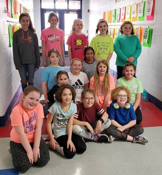 Photo of the 15 girls from CMZ participating in Girls on the Run