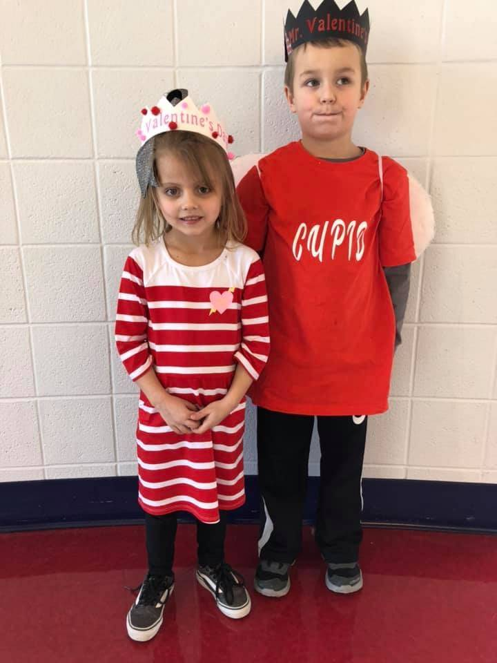 two students wearing red and white clothing for valentine's day