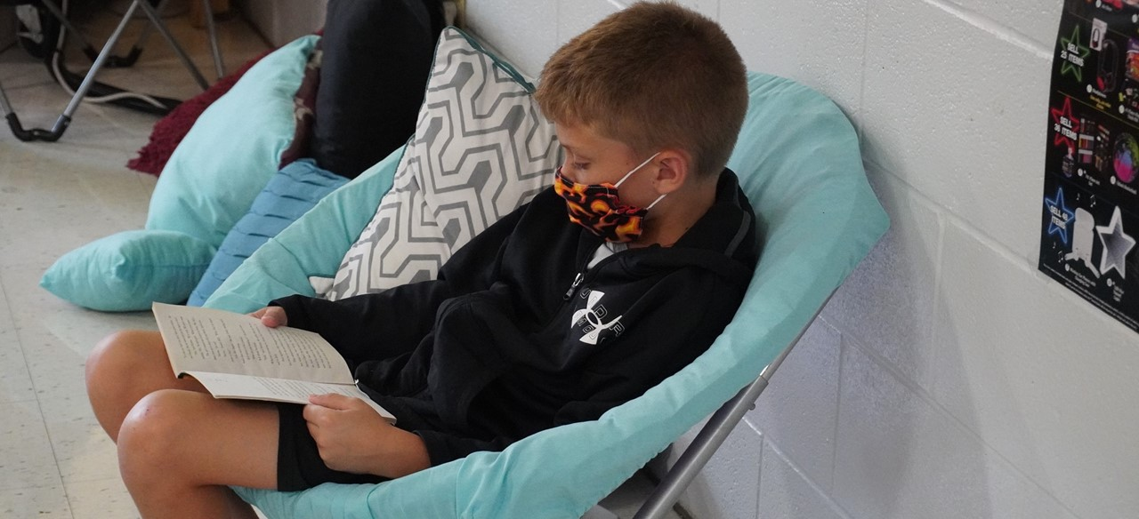 student reading in chair