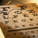 Image of eye chart and pair of glasses